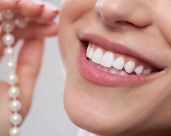 Patient smiling with Prepless Dental Veneers